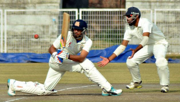 Punjab-cricketer-Yuvraj-Singh-plays-a-shot-against-Haryana