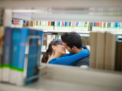 college-students-kissing-in-library