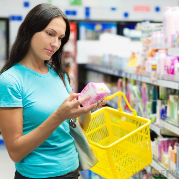 woman-buying-feminine-hygiene-products