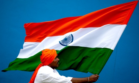 epa03824286 An Indian man holds an Indian flag at Freedom Park in Bangalore, India, 14 August 2013. India celebrates its Independence Day on 15 August.  EPA/JAGADEESH NV