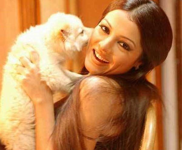 Celina-Jaitley-is-a-PETA-activist-not-just-for-the-sake-of-it-Very-much-into-pet-indulgence-she-has-many-canine-pets-at-her-home