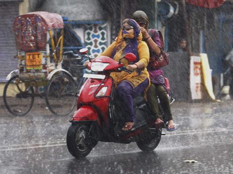 People enjoying Monsoon rain in Allahabad