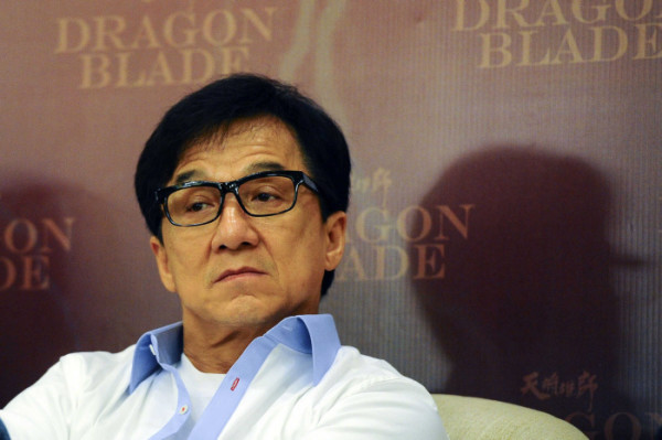 """Hong Kong actor Jackie Chan looks on during a press conference to promote his new movie """" Dragon Blade"""" in a hotel in Kuala Lumpur, Malaysia, on Wednesday, Feb. 11, 2015. (AP Photo/Joshua Paul)"""