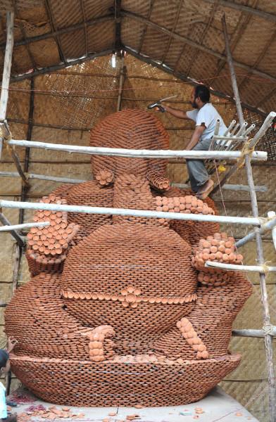 Lord Ganesha made of clay diyas