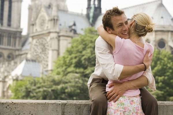 France, Paris, couple embracing, man smiling