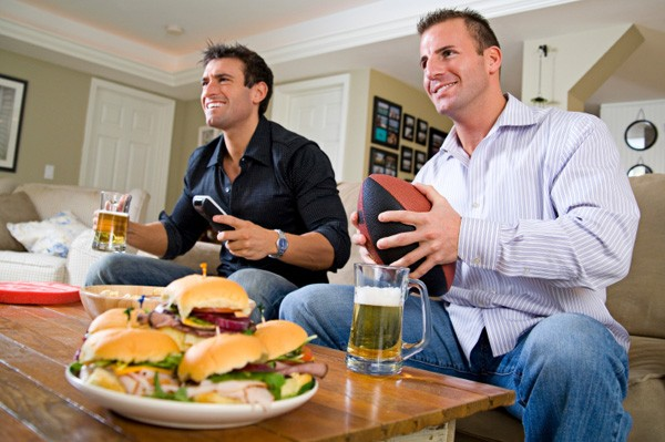 men-watching-tv-football-sandwiches