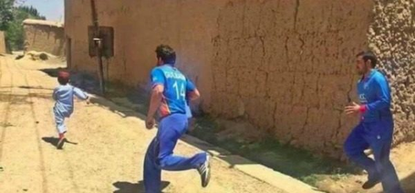 Afghanistan Players Chasing A Kid