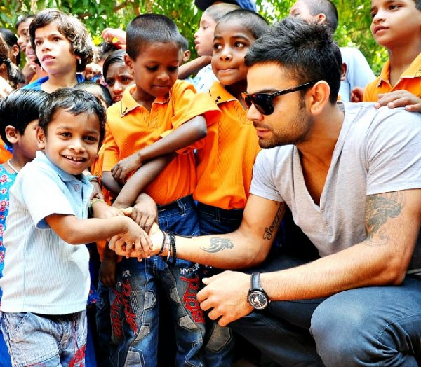 Virat Kohli with kid
