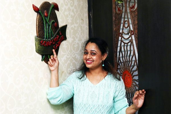 sonalika's name plate on the enterance of home