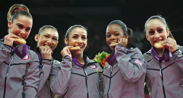 olympians biting their medals