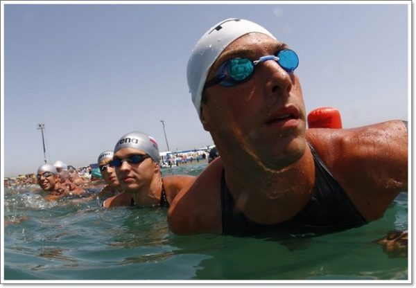 Crippen of US and Drattsev of Russia wait for start of men's 10 km open water race at swimming world championships in Ostia