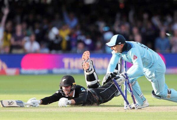 England s Jos Buttler runs out New Zealand s Martin Guptill